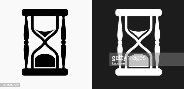 Hourglass Icon on Black and White Vector Backgrounds