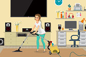 Housewife vacuuming home with a vacuum cleaner in the room