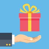 Human hand and gift box. Modern flat design. Vector illustration