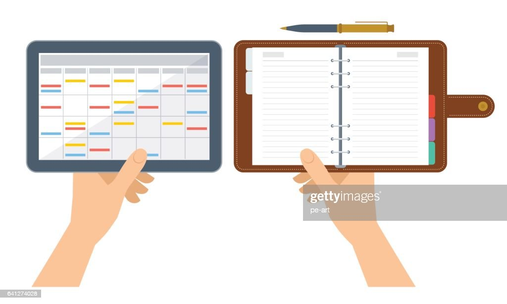 Human hands are holding electronic and paper organizer and planner.