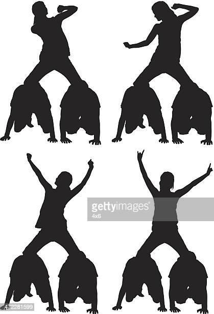 ilustrações, clipart, desenhos animados e ícones de pirâmide humana garota dançando em - engatinhando