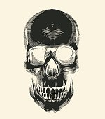Human skull silhouette drawn in vintage engraving or woodcut style