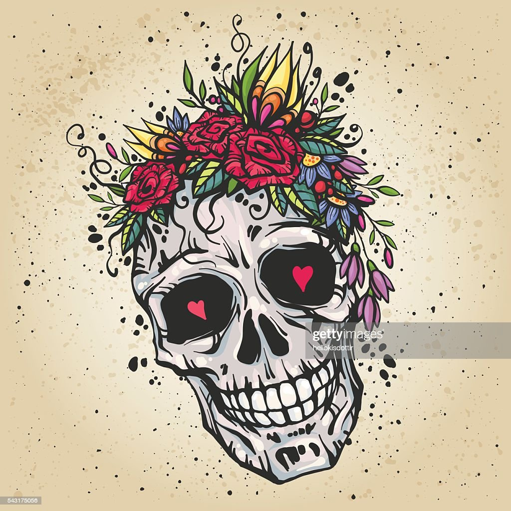 Human skull with flower wreath