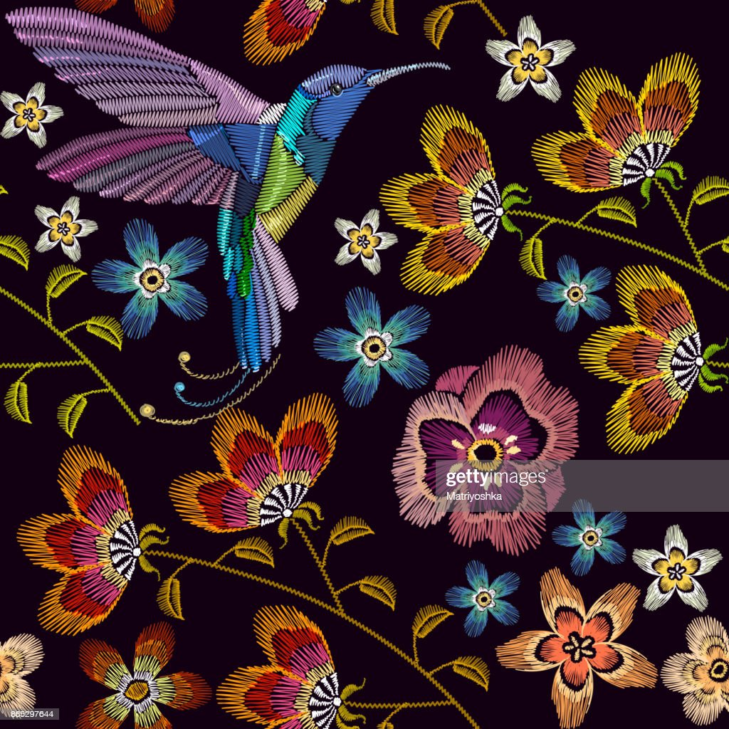 Humming bird and flowers embroidery seamless pattern. Template for clothes, textiles, t-shirt design. Beautiful hummingbirds and spring flowers embroidery on black background