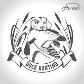 Hunting. Vector illustration. Dog with duck in his mouth.
