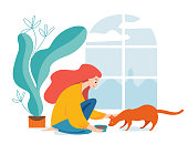 Hygge illustration with a woman feed a cat