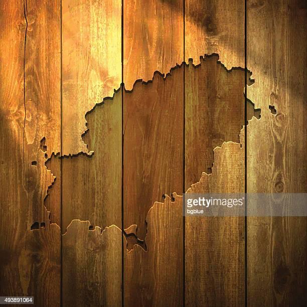 ibiza map on lit wooden background - ibiza island stock illustrations