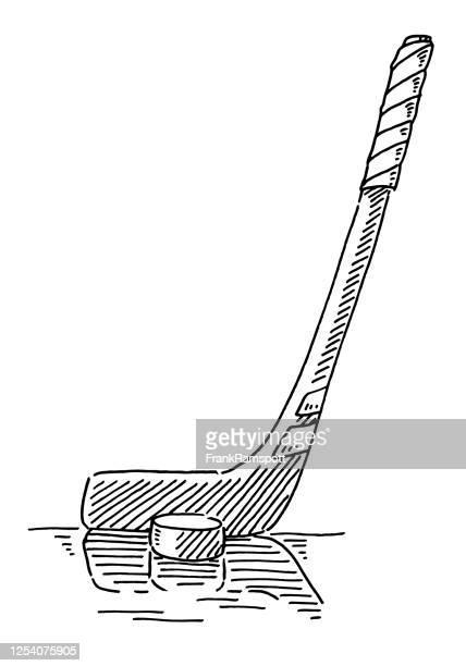ice hockey stick and puck drawing - ice hockey stick stock illustrations