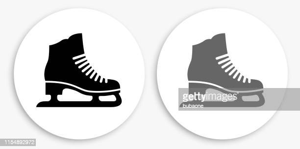 ice skates black and white round icon - ice skate stock illustrations, clip art, cartoons, & icons