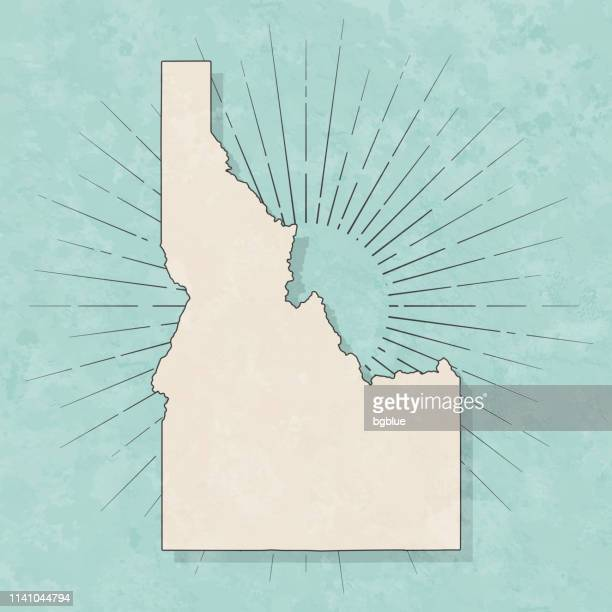 idaho map in retro vintage style - old textured paper - idaho stock illustrations