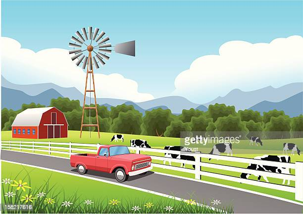 Idyllic Farm Scene with Truck in the Foreground.