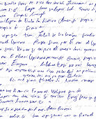Illegible blue handwritten scribble on white paper