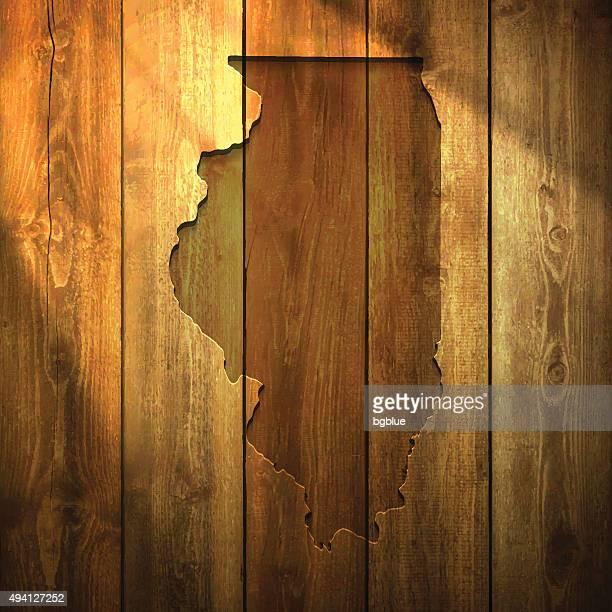 illinois map on lit wooden background - chicago illinois stock illustrations