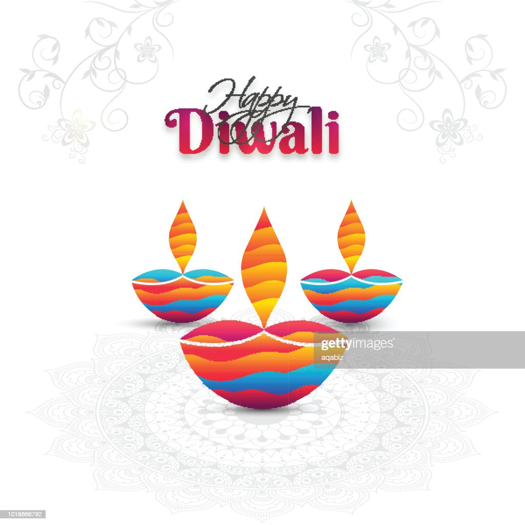 Illuminated colorful oil lamps (Diya) on floral mandala decorated white background for Diwali festival celebration. Can be used as greeting card design.