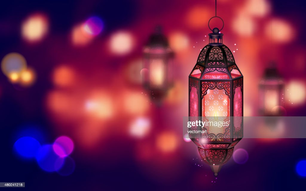 Illuminated lamp on Ramadan Kareem background