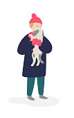 Illustration of a girl playing with a dog. Vector. Girl teenager in a coat and hat holding a dog. Flat cartoon style. Pet for a walk. The relationship between man and animal.