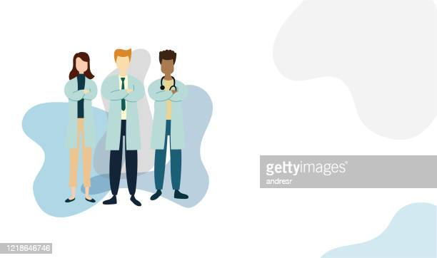 illustration of a group of doctors with arms crossed - essential services stock illustrations