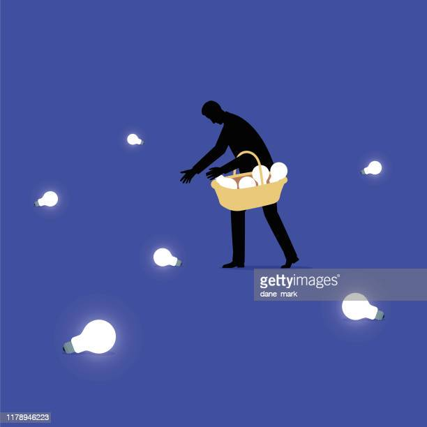 illustration of a man picking up lightbulbs and putting them in a basket - ideas stock illustrations