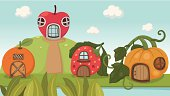 Illustration of a strawberry house and pumpkin house and orange house.