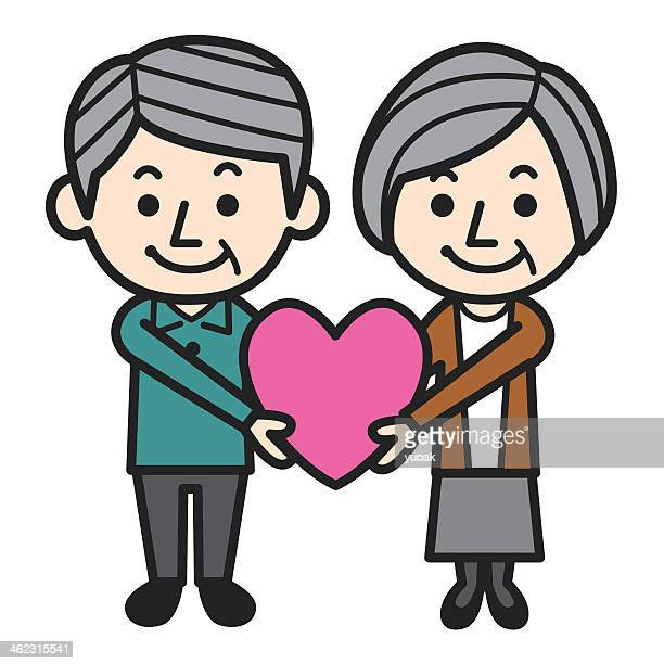 Illustration of an elderly couple holding a pink loveheart