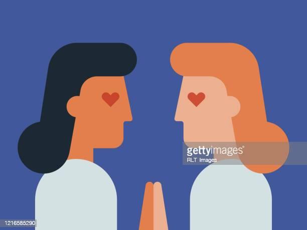 恋に若いカップルと向き合う顔のイラスト - レズビアン点のイラスト素材/クリップアート素材/マンガ素材/アイコン素材