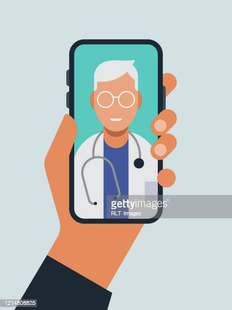 illustration of hand holding smart phone with doctor on screen during telemedicine doctor visit - using phone stock illustrations