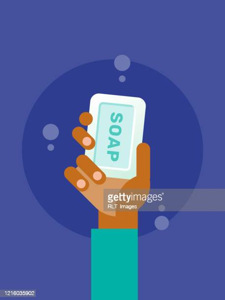 illustration of hand holding up bar of soap - washing hands stock illustrations