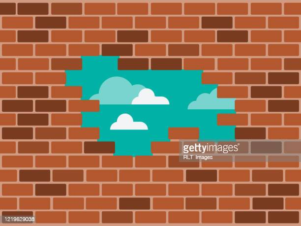 illustration of hole in brick wall with blue sky shining through - grief stock illustrations