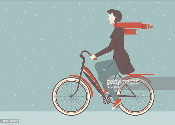 Illustration of woman in scarf riding a bicycle in the snow