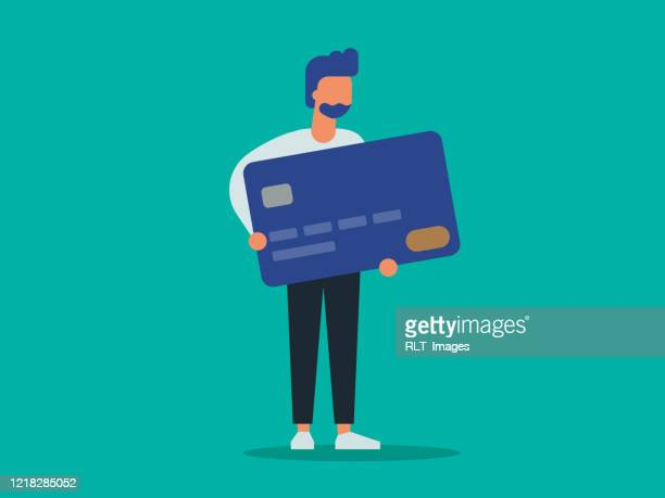 illustration of young man holding giant credit card - credit card stock illustrations