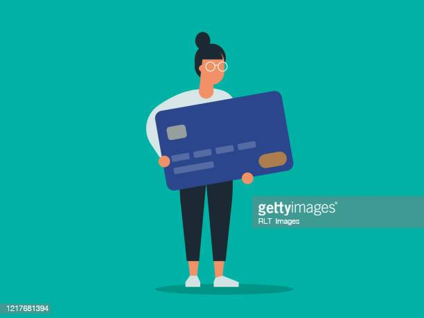 illustration of young woman holding giant credit card - credit card stock illustrations