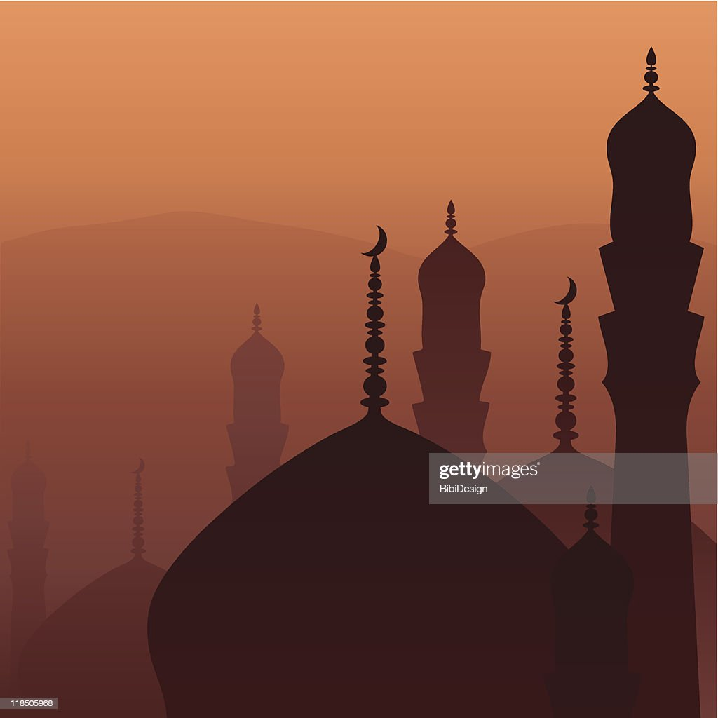 Image of silhouettes of tops of Arabian buildings at sunset