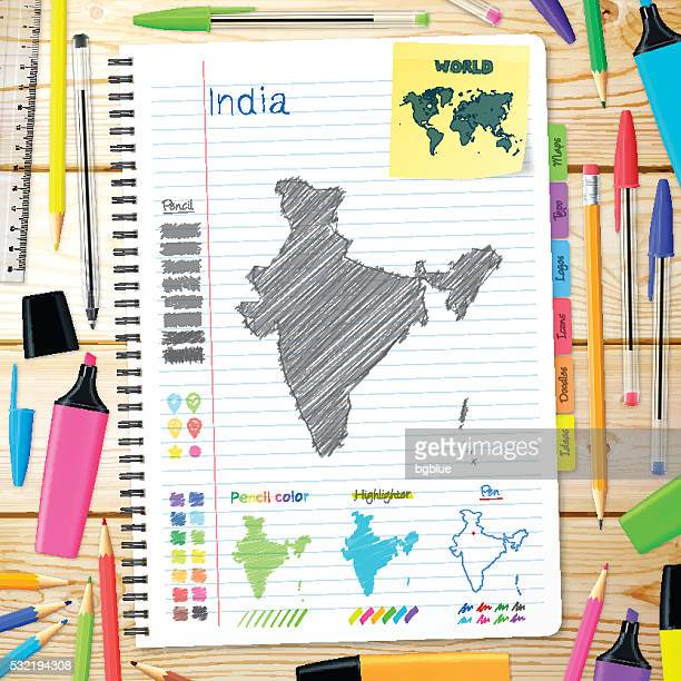India maps hand drawn on notebook. Wooden Background