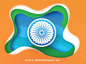 Indian Independence Day celebration concept with Ashoka Wheel on paper layered background.