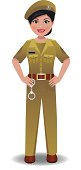 Indian Police woman in uniform standing with hands on hips