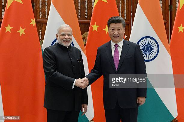 Indian Prime Minister Narendra Modi shakes hands with Chinese President Xi Jinping at the West Lake State Guest House on September 4 2016 in Hangzhou...
