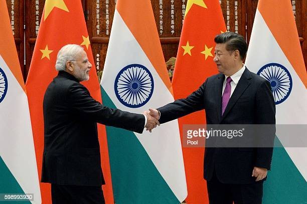 Indian Prime Minister Narendra Modi shakes hands with Chinese President Xi Jinping at the West Lake State Guest House on September 4, 2016 in...
