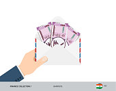 2000 Indian Rupee Banknotes in envelope hold in hand. Flat style opened white envelope with cash. Salary payout or corruption concept.