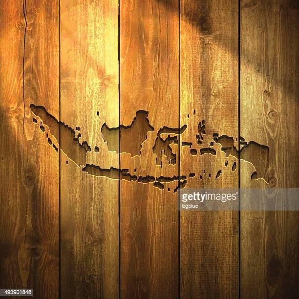 インドネシアマップで明るい木製の背景