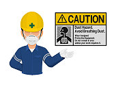 Industrial worker is presenting Dust hazard warning sign