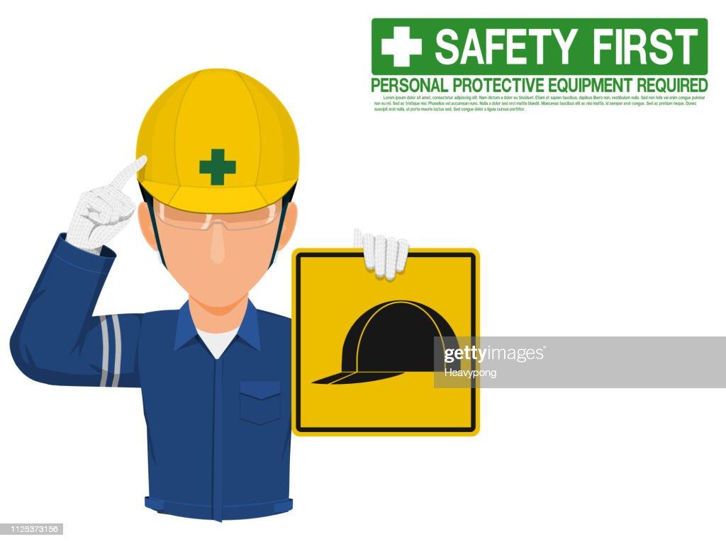 Industrial worker is presenting helmet sign