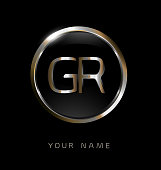 GR initial letters with circle elegant logo golden silver black background