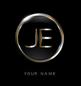 JE initial letters with circle elegant logo golden silver black background