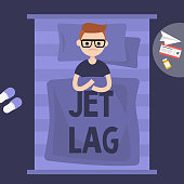 Insomnia. Jet Lag. Young exhausted character lying in the bed. Flat editable vector illustration, clip art