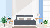 Interior design of modern apartments in gray-blue color. Large king size bed, flowers, alarm clock, books, lamp, window. Vector flat illustration