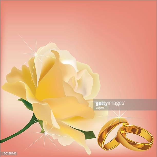 Invitation carte avec Anneaux de mariage et rose blanche