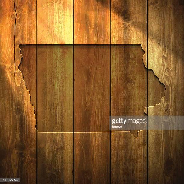 Iowa Map on lit Wooden Background