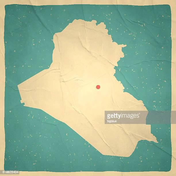 iraq map on old paper - vintage texture - iraq stock illustrations
