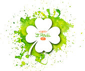 Irish holiday Saint Patrick's Day. White quatrefoil clover on abstract green waterolor background.