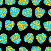 Irregular abstract shapes. Teal and lime dots on a black background. Vector seamless pattern. Great for fabric prints, paper projects, and packaging.